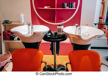 Modern wash basins in hairdressing salon, nobody