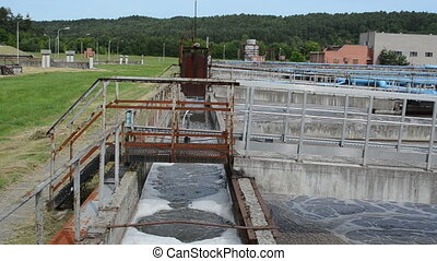 Panorama of modern sewage waste water treatment cleaning plant. aeration basin bubbling and big pipes blowing oxygen. Polluted water cleaning technology.