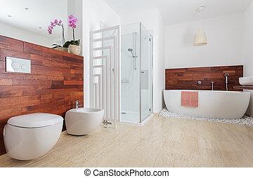 Modern white bathroom with shower and bath
