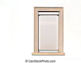 Modern white closed window on a building wall (outside exterior)