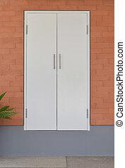 modern white door on brick wall background