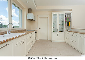 Modern white kitchen with granite tops