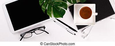 Modern white office desk table with tablet, eyeglasses, pen...