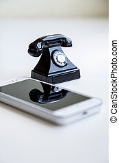 smartphone and toy retro telephone