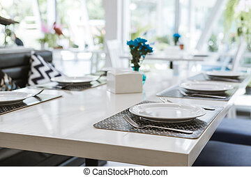 Modern white table in dining room