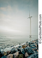 modern white wind turbine for generation of renewable...