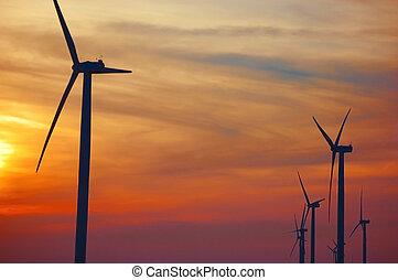 Modern Wind Turbines on Wind Farm - Silhouettes of Modern...