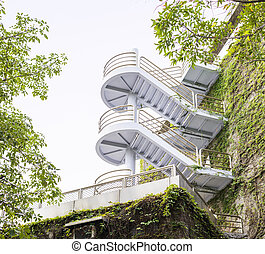 Modern Winding Staircases on Vine Covered Exterior Walls of Buil