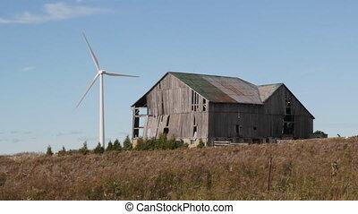 Modern windmill. Old barn.