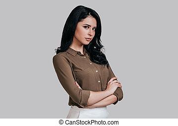 Modern woman. Beautiful young woman in smart casual wear...