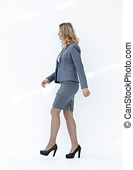 modern woman confidently striding forward.isolated on...
