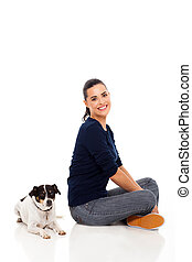 modern woman sitting with her pet dog - cheerful modern...