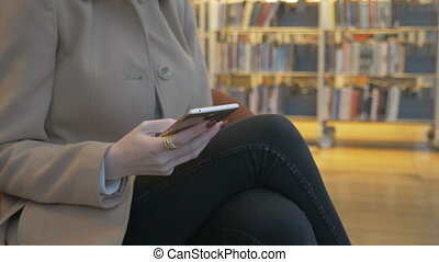modern woman texting sms on a smartphone