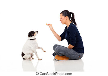 modern woman training a dog isolated on white background