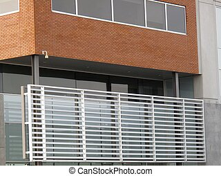 Modern wood and glass panels embedded in a building with metal screen