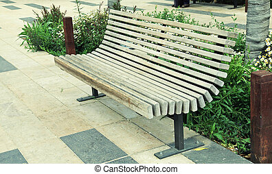 modern wood bench on the city street