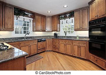 Modern wood paneled kitchen