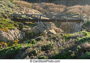 Modern Wooden Bridge Over Rocky Canyon