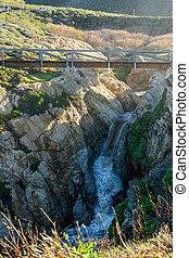 Modern Wooden Bridge Over Waterfall
