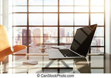 modern workplace with a laptop at sunrise