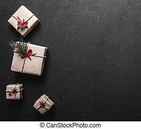 Modern Xmas gifts on a dark background with copy space. Christmas background. View from above. Flat lay