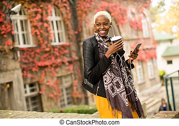 Modern young african american woman outdoor