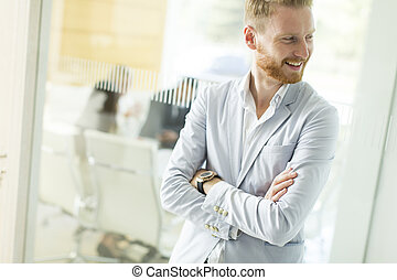 Modern young businessman in the office