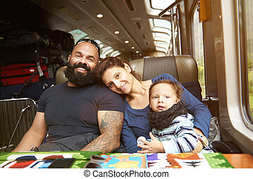 Modern young family in train