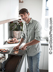 young man preparing Breakfast in his kitchen