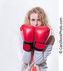 modern young woman in red Boxing gloves