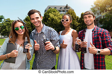 Modern youth relaxing outdoors - Millennials. Happy and glad...