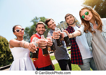 Modern youth relaxing outdoors - Celebrate your life....