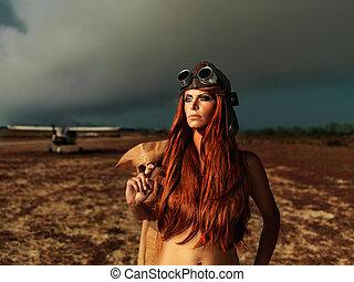 moderno, aviador, mujer, con, smokey, avión