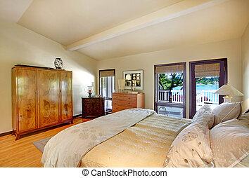 moderno, lujo, dormitorio, con, cama, tocador, y, lago, vista.