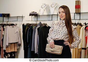 modieus, jonge vrouw , in, een, mode, toonzaal