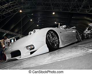 Aggressive Japanese modified car on show at a motorshow