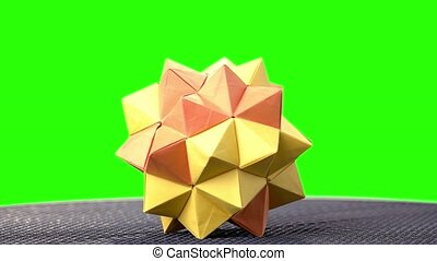 Modular origami ball on green screen. 3d modular origami...