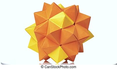Modular origami figure on white background. Yellow origami...