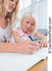 moeder en dochter, tekening, aan tafel