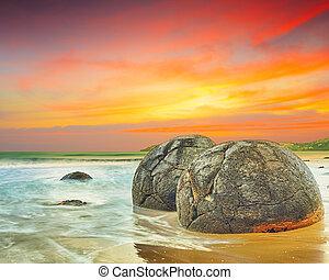 Moeraki Boulders at sunset. New Zealand
