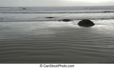 Moeraki boulders in the Pacific Ocean waves - Impressive...
