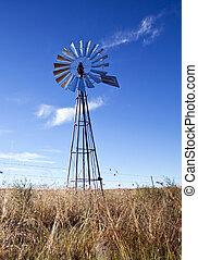 moinho de vento, com, sol, levantar, céu azul