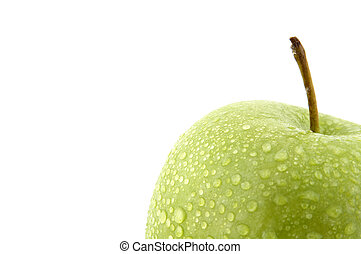 Moist green apple - A close up of a green apple covered in...