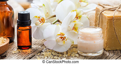 Moisturizing cream and orchid - spa concept - Moisturizing...