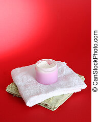 Moisturizing cream on red background
