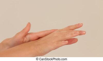 Moisturizing cream - Woman using moisturizing cream for...