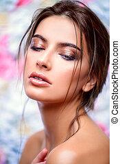 moisturizing the skin - Beautiful sensual woman posing on a...