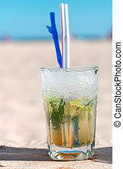 Mojito cocktail on a beach