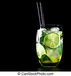 Mojito cocktail on black background with lime and mint with ...