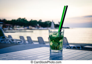 mojito cocktail on the beach